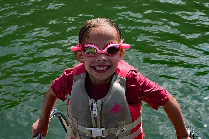 little girl with swimming googles on